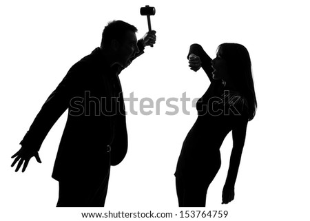 one caucasian couple man and woman expressing domestic violence in studio silhouette isolated on white background - stock photo