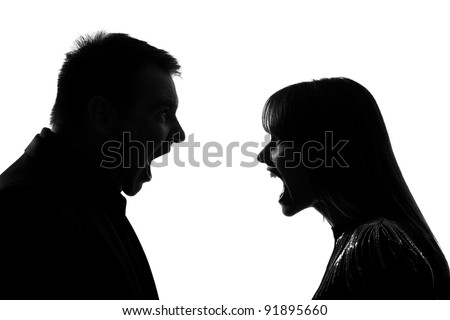 one caucasian couple man and woman face to face screaming shouting dipute in studio silhouette isolated on white background - stock photo
