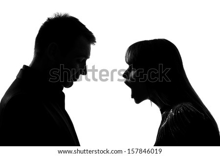 one caucasian couple man and woman face to face screaming shouting dispute in studio silhouette isolated on white background - stock photo