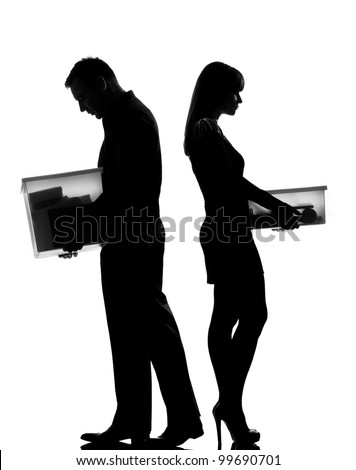 one caucasian couple man and woman in studio silhouette isolated on white background - stock photo