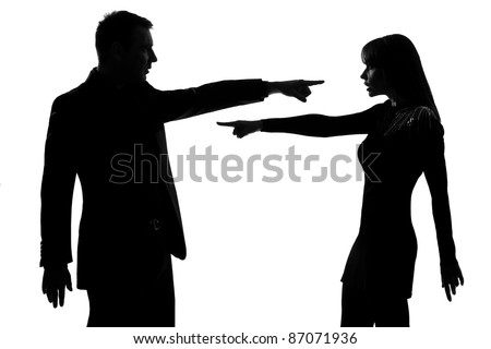 one caucasian couple man and woman pointing at each other expressing accusation in studio silhouette isolated on white background - stock photo