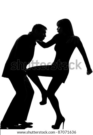 one caucasian couple man and woman self defense  domestic violence in studio silhouette isolated on white background - stock photo