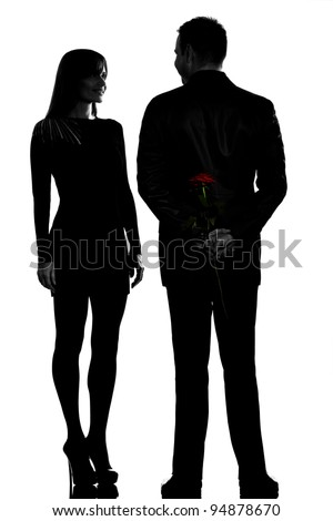 one caucasian couple man and woman smiling in studio silhouette isolated on white background - stock photo
