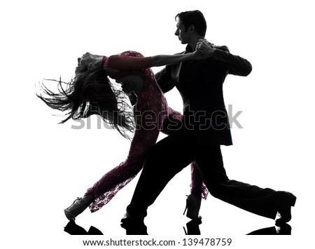 one caucasian couple man woman ballroom dancers tangoing  in silhouette studio isolated on white background - stock photo