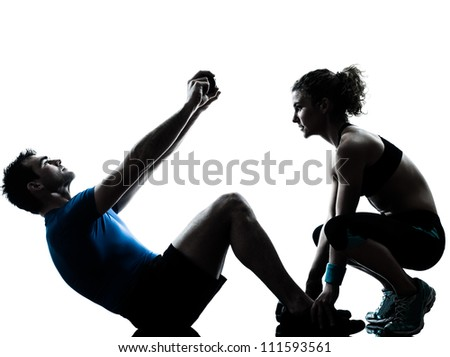 one caucasian couple man woman personal trainer coach exercising abdominal silhouette studio isolated on white background