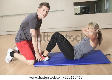 one caucasian couple man woman personal trainer coach exercising abdominal silhouette studio isolated on white background - stock photo