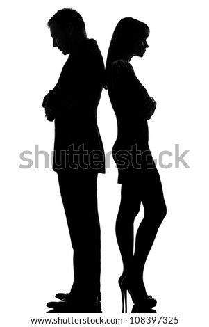one caucasian couple standing back to back man and woman sad in studio silhouette isolated on white background - stock photo