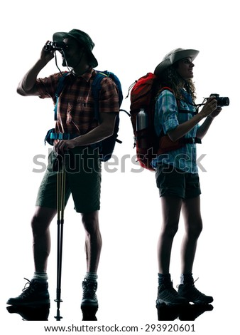 one caucasian couple trekker trekking Photographing nature in silhouette isolated on white background - stock photo