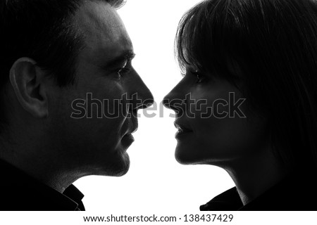one caucasian couple woman man face to face in silhouette studio isolated on white background - stock photo