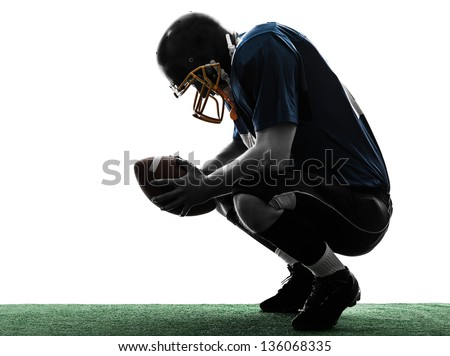 one caucasian defeated american football player man in silhouette studio isolated on white background - stock photo