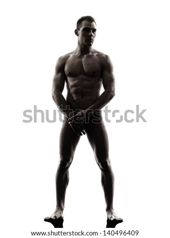 one caucasian handsome naked muscular man tanding full length in silhouette studio on white background