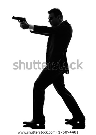 one caucasian killer man in silhouette  on white background - stock photo