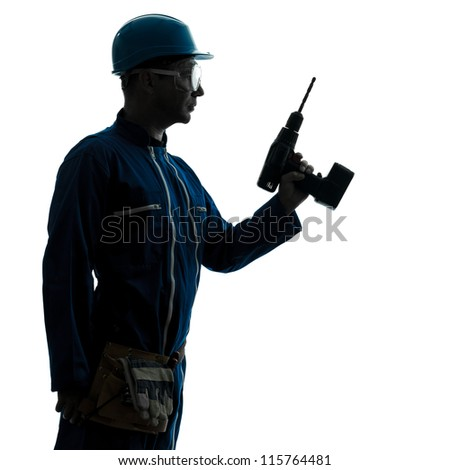one caucasian man construction worker holding drill silhouette in studio on white background