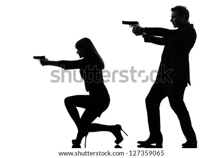 one caucasian man detective secret agent criminal  with gun  in silhouette studio isolated on white background - stock photo
