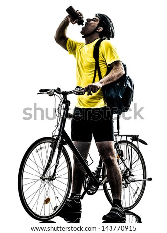one caucasian man exercising bicycle mountain bike drinking   on white background
