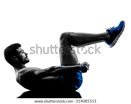 one caucasian man exercising crunches  fitness weights exercises in studio silhouette isolated on white background - stock photo
