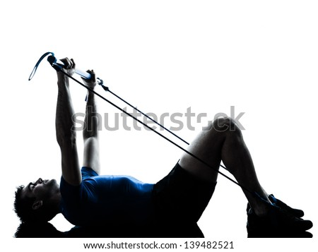 one caucasian man exercising gymstick workout fitness in silhouette studio  isolated on white background - stock photo