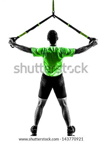 one caucasian man exercising   suspension training  trx   on white background - stock photo
