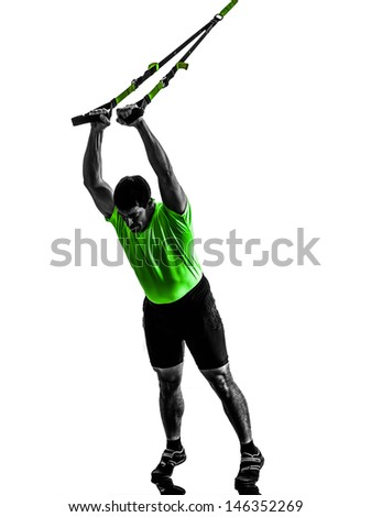 one caucasian man exercising   suspension training  trx   on white background - stock photo