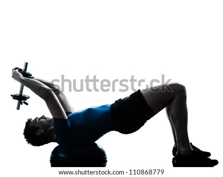 one caucasian man exercising weight training bosu workout fitness in silhouette studio  isolated on white background - stock photo