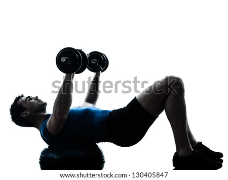 one caucasian man exercising weight training on bosu workout fitness in silhouette studio  isolated on white background