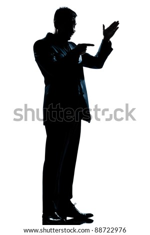 one caucasian man friendly menacing full length silhouette in studio isolated white background - stock photo