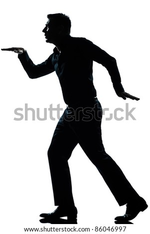 one caucasian man funny egyptian style walking  full length silhouette in studio isolated white background - stock photo