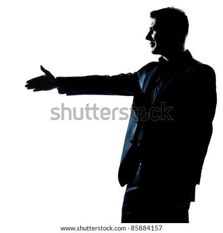one caucasian man handshake profile portrait silhouette in studio isolated white background - stock photo