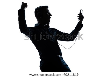 one caucasian man happy listening to music portrait silhouette in studio isolated white background - stock photo