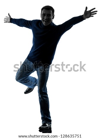 one caucasian man happy saluting  full length in silhouette studio isolated on white background - stock photo