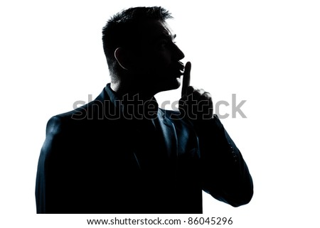 one caucasian man hushing profile portrait silhouette in studio isolated white background