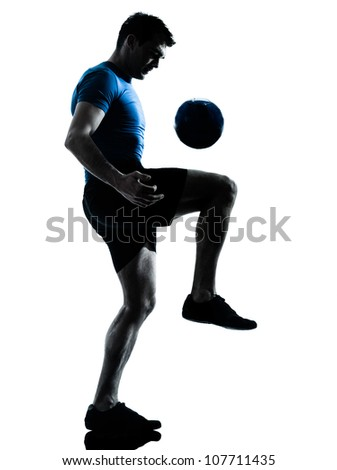 one caucasian man playing soccer football player silhouette  in studio isolated on white background - stock photo