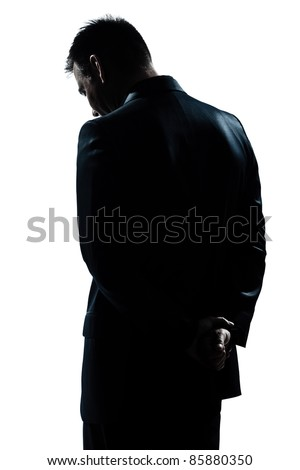one caucasian man portrait silhouette backside sad despair lonely in studio isolated white background - stock photo