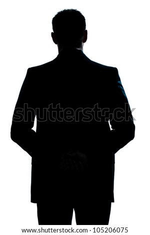 one caucasian man portrait silhouette backside standing hands behind back in studio isolated white background - stock photo