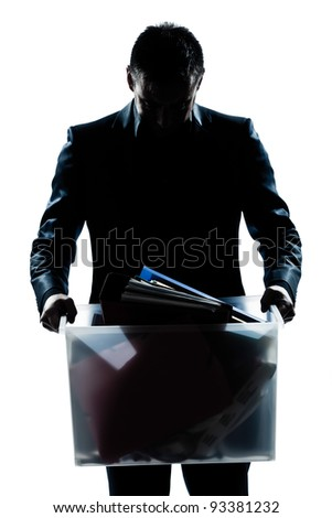 one caucasian man portrait silhouette carrying heavy box in studio isolated white background