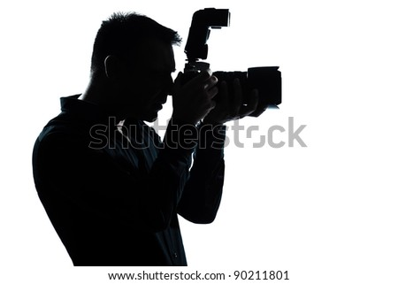 one caucasian man portrait silhouette photographer in studio isolated on white background - stock photo