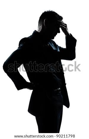 one caucasian man portrait silhouette tired migraine backache in studio isolated on white background - stock photo