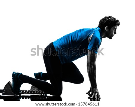 one caucasian man runner sprinter on starting blocks  in silhouette studio isolated on white background - stock photo