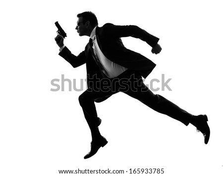 one caucasian man running with handgun  in silhouette  on white background - stock photo