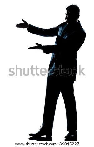 one caucasian man showing pointing empty copy space  full length silhouette in studio isolated white background - stock photo