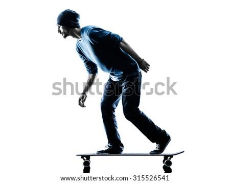 one caucasian man skateboarder skateboarding  in silhouette isolated on white background - stock photo