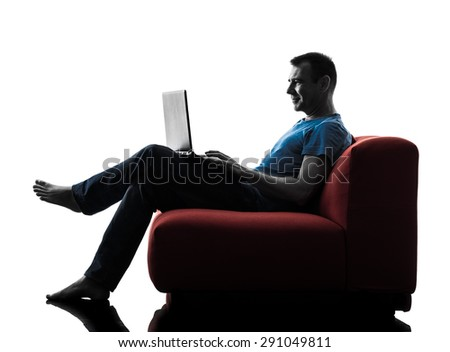 one caucasian man sofa coach computer computing laptop in silhouette isolated on white background - stock photo