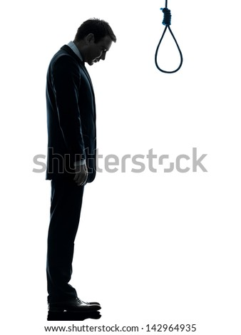 one caucasian man standing in front of hangman's noose in silhouette studio isolated on white background - stock photo