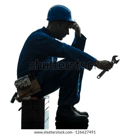 one caucasian repairman worker sad fatigue failure  silhouette in studio on white background