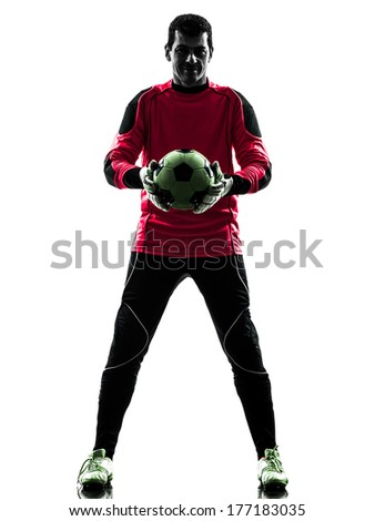 one caucasian soccer player goalkeeper man standing holding ball in silhouette isolated white background - stock photo