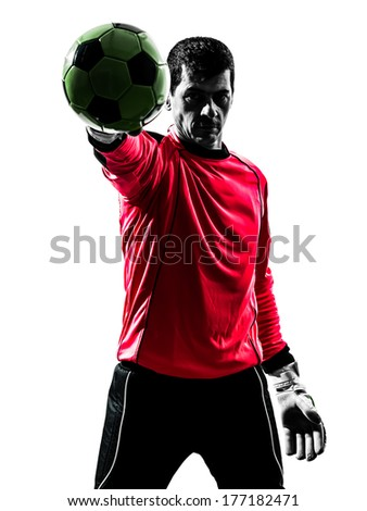 one caucasian soccer player goalkeeper man standing stopping ball with one hand in silhouette isolated white background - stock photo
