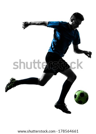one caucasian soccer player man juggling ball in silhouette isolated white background - stock photo