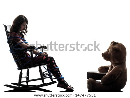 one caucasian strange young woman and teddy bear storytelling in silhouette white background - stock photo