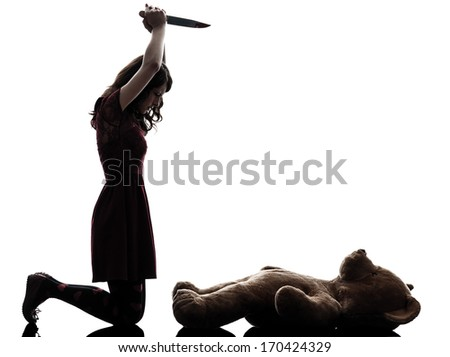one caucasian strange young woman killing her teddy bear in silhouette white background - stock photo