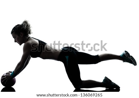 Fitness ball workout posture in silhouette studio isolated on white